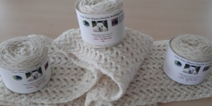Ivory lacey scarf close up with 3 balls x 50g
